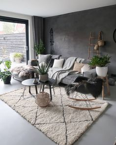 Nordic style living room with white geometric rug, grey sofa, plants and cushion. - Nordic style living room with white geometric rug, grey sofa, plants and cushions - Chic Living Room, Living Room Grey, Rugs In Living Room, Nordic Living Room, Living Room Cushions, Living Room Decor With Plants, Living Room With Carpet, Charcoal Sofa Living Room, Cozy Living Room Warm