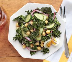 Healthy Side Dishes for Your Labor Day Shindig: Quick-Pickled Kale Salad. Toss the superfood green with some onions, eggs and cukes for a delish healthy side salad. #SelfMagazine