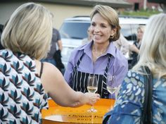 "Andrea greeting guests as they arrive at ""The Art of Wood-Fired Cooking"" school in Healdsburg, CA."