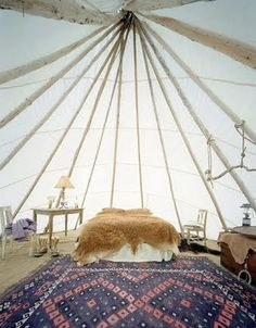 A huge teepee with king size bed and wood burning stove nestled in the woods! / The Green Life <3