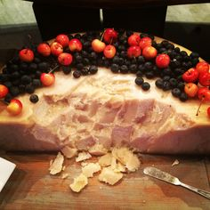 Wheel of Parmesan Reggiano topped with fresh berries and cherries
