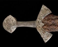 Here is a close-up image of the Viking sword discovered in an 11th-century…