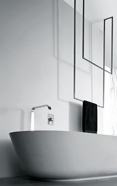 Striking bath | Black & White Bathroom | Modern Minimalist Interiors | towel bar hook Contemporary Decor Design #inspiration #nakedstyle