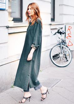 Maja Wyh in a forest green Ganni dress and studded heels