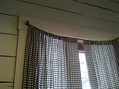 re-use old spools of thread to hang little curtains! quick and easy! I love this idea!!!