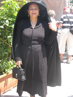 Hood and cloak in one, made invariably of black cloth gathered on to a frame held in the right hand. Tradition says that the Maltese women adopted the faldetta to hide their faces from their French conquerors. | Malta