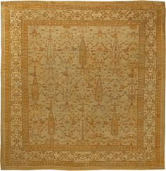 This circa-1920 antique Turkish Oushak rug features an all-over design of floral and geometric abstractions, as well as stylized animal shapes, in shades of beige and green against a lighter beige field. A geometric main border surrounds the antique carpet. Oushak rugs are renowned for their silky, luminous wool and a weaving pattern that employs traditional tribal techniques, namely the use of larger knots and an all-wool foundation. As these works are often considered some of the finest…