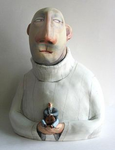Eli Kaluga Innocent :  Eli worked for many years in a porcelain factory, and has since branched out to producing miniture figurines, usually of a lively and expressive nature.