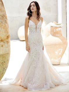 25548 - Inga - Seek out complementary patterns in nature—stars in flowers, blooms in galaxies, currents in sunlight. Cue this gorgeous lace mermaid wedding dress to showcase them all.  Try this beauty on at Aurora Bridal in Melbourne, FL 321-254-3880