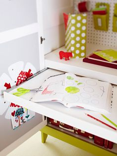 Craft Supply & Demand, cont.  Add even more benefit to a storage armoire with a pullout work surface. A piece of painted plywood underneath a shelf rolls out on a mounted drawer glide. A strip of wood placed on the front of the pullout desk finishes the desk and catches any wayward pencils