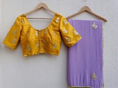 Featuring a lavendar saree in georgette base with hand embroidered gota patti motifs all over. It is paired with Mustard yellow contrast blouse in dupion with matching embroidery on sleeves and back/front. Yellow Saree, Green Saree, Yellow Blouse, Fancy Sarees, Party Wear Sarees, Gota Patti Saree, Mirror Work Saree, Saree Floral, Simple Sarees