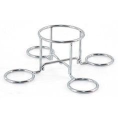 This is what is used inside a terra cotta pot heater >> Master Forge Beer Can Chicken Rack $4.99 at Lowes.com
