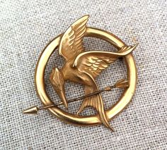 This is a pin of a mockingjay. The mockingjay becomes the symbol of Katniss, and the rebellion she is leading against the Capitol.
