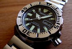 """The 21-jewel, automatic Seiko Men's """"Black Monster"""" Automatic Dive Watch winds itself with the motion of your wrist, so you'll never need to change..."""
