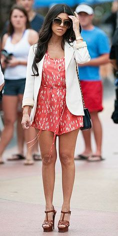 What baby weight? The reality star shows off a trim body-after-baby in a red printed silk romper, white blazer and sky-high YSL sandals while out in Miami Beach, Florida.