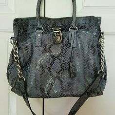 On hold MICHAEL KORS SNAKESKIN HAMILTON! TRADED TO SAMANTHA! MICHAEK KORS SNAKESKIN HAMILTON! Bag is grey/silver. In immaculate condition inside and out. No scratches on the hardware. Beautiful for any MK lover! Has one zipper pocket and 4 cell phone pockets for whatever you need.  Perfect for any MK lover. Can be carried as a satchel or shoulder bag. Comes with original dustbag. TV original price Michael Kors Bags Shoulder Bags