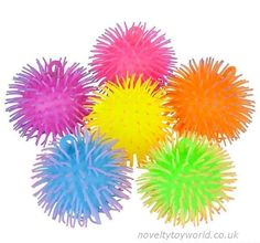 Novelty puffer balls in assorted two tone colours. A soft and squeezable sensory novelty measuring 11cm. Wholesale bulk buy from 96 units.