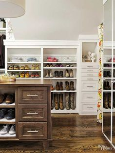 Good looks need to be purposeful in a shared, hardworking closet. Clean-line drawer pulls on built-ins and the island make the space feel grand yet modern. Niches for artwork and accessories tuck under the eaves and combine display and function.
