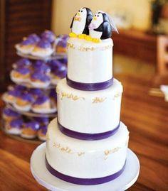 Wedding Cakes: Purple ribbon wedding cake with penguin topper