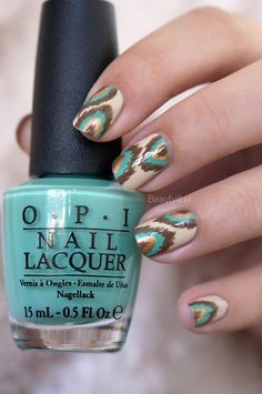 Ikat Nail Art inspired by OPI - colors used; Vanilla colored polish (OPI, You're So Vain-illa) Mint colored polish (OPI, My Dogsled Is A Hybrid) Golden nailpolish (OPI, OPI With A Nice Finn-ish) Taupe colored polish (OPI, A-Taupe The Space Needle)