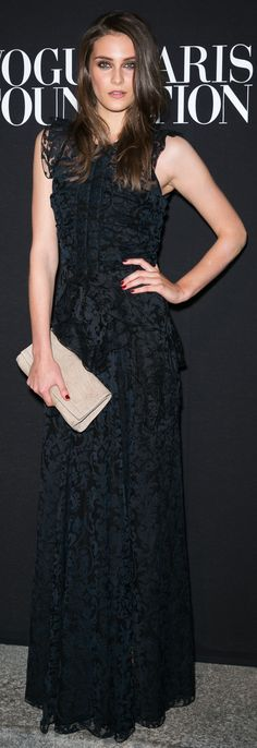 British model Charlotte Wiggins wearing a black lace Burberry Prorsum dress to attend the Vogue Paris Foundation Gala