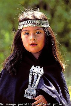 Little Mapuche girl dressed up for a tribal gathering near Temuco, Chile. Mapuche is a collective name referring to the indigenous people of South Central Chile and Southwestern Argentina