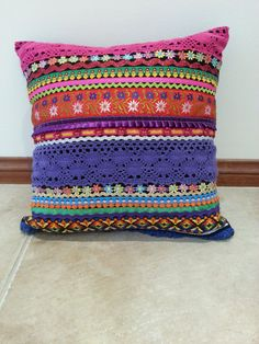 Check out this item in my Etsy shop https://www.etsy.com/au/listing/180583392/multi-coloured-ribbon-and-braid-cushion