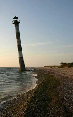 Abandoned Kiipsaare Lighthouse Saaremaa Estonia(One assumes access to the tower was gained at low tide, a technique which may not be doable much longer as the coastline of Saaremaa continues its losing battle with the Baltic Sea.)
