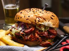 This manly sandwich is all about extremes.  Two meats – beer-soaked barbecued pork and beef smoked sausage – are piled high on an onion bun with coleslaw and pickles to top it off.  Its a messy but awesome creation.
