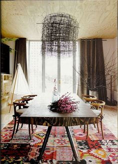 Stunning & unique room design. Love it. - Plywood ceiling and floor; nest-like chandelier; patchwork rug by Loom Rugs; mid century table; wishbone chairs