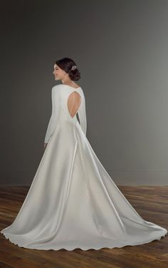 Martina Liana Bridal 1157 This simple ballgown features all the elegant simplicity of a modern-day duchess! A clean, high neckline rests just beneath the collarbone Wedding Dress Sleeves, Long Sleeve Wedding, Simple Classy Wedding Dress, Elegant Wedding, Martina Liana, Bohemian Beach Wedding Dress, Wedding Dress Silhouette, Designer Wedding Dresses, Ball Gowns