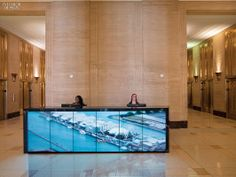 Interior Design Magazine: Motorola's lobby has a desk fronted by screens that cycle between city scenes.  #InteriorDesignMagazine #InteriorDesign #design