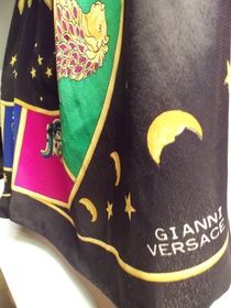 """Gianni Versace Zodiac Silk Scarf        This is gorgeous 100% silk scarf designed by Gianni Versace. It features the signs of the zodiac in beautiful colors on a black silk celestial back drop. It measures 34"""" around.     3-       $85.00"""