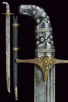 Sword, straight single-edged blade, with triple fuller, at the forte a deep star-shaped stamp; iron quillon with langets and straight arms ending in bulb, featuring remains of gold inlays depicting floral motifs; wooden grip with black leather covering, silver plaques nielloed with floral motifs and studs. Wooden scabbard with black leather covering, chape and bands decorated en suite with the quillon, provenance: Georgia, dimensions: length 87,5 cm. dating: 20th Century.