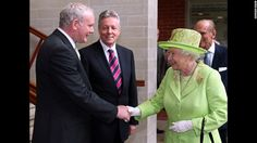 """An historic moment was made when <a href=""""http://edition.cnn.com/2012/06/26/world/europe/northern-ireland-mcguinness-queen-handshake/"""">Queen Elizabeth II</a> shook  hands with Northern Ireland Deputy First Minister Martin McGuinness as First Minister Peter Robinson looks on at the Lyric Theatre in Belfast, Northern Ireland, on June 27, 2012. A simple handshake marks a step forward in the peace process relating to British rule of Northern Ireland."""