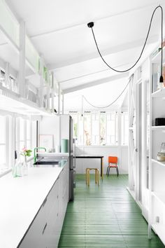 I love the lightness, the mass of counter space, and the green floors.