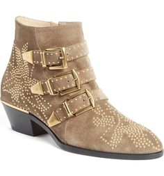 Head over heels for these Chloe boots! Golden studs pepper the soft suede for an elevated Western vibe.