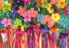 These Mexican tissue paper flowers were turned into floral crowns for guests to adorn themselves Mexican fiesta style--how fun!
