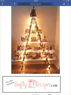 """Here's a lovely idea to do if you have an old ladder in the garage! Make a beautiful Christmas village with lights and houses! This was made by Lydia Mendoza. She says """"I had an old ladder from a yard sale. I put planks of wood that I painted white on the All Things Christmas, Winter Christmas, Christmas Home, Ladder Christmas Tree, Christmas Tree Made Of Lights, Xmas Tree, Christmas Village Display, Christmas Villages, Christmas Village Houses"""