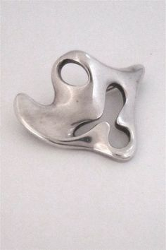 Georg Jensen, Denmark - sterling modernist brooch # 322 by Henning Koppel