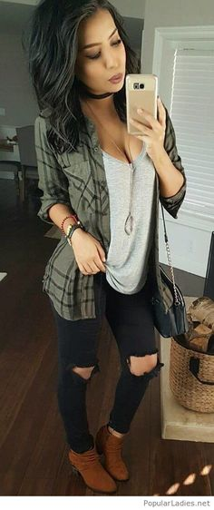 Grey top, black jeans and olive plaid shirt