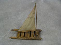 Toy Boat Wood Boat Sail Boat -- I think we can make this using scrap strips from old sheets and Popsicle sticks! Yes? :)