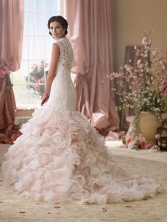 Style 114276, Crawley is a romantic blush pink wedding dress with a ruffled skirt designed by David Tutera for Mon Cheri. Click for details on this style.