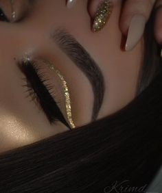 Gold glitter cut crease line.