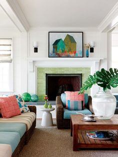 love the green tile and picture over the fireplace.  could do without the furniture.