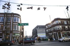 In depth Seattle Times article looks at the effects of nightlife and gentrification on Capitol Hlil. Photo caption: At Pike Street and 11th Avenue, shoes hang on a wire near rehabilitated old buildings and a new one going up. (Bettina Hansen/The Seattle Times)