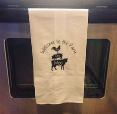 Bought this cute Farm Animal SVG file from Etsy shop @ChrissysDesignShopDE, and applied iron on to linen flour sack towel from Michael's from r my mom's black & white kitchen decor. Cow, chicken, pig, Welcome to the Farm. Cricut project