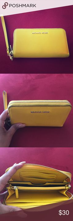 Bright yellow MK wallet. Yellow pre-loved but still in good condition. KORS Michael Kors Bags Wallets