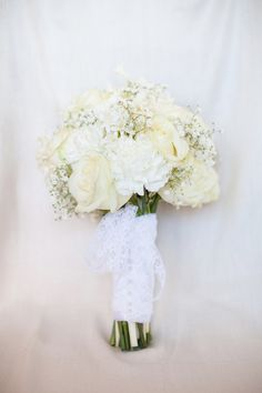 Beautiful white bridal bouquet with a mix of flowers ~ Whimsical Wonderland Weddings