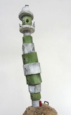 Green and white lighthouse made from driftwood at the Seven Heads Peninsula West-Cork, Ireland.